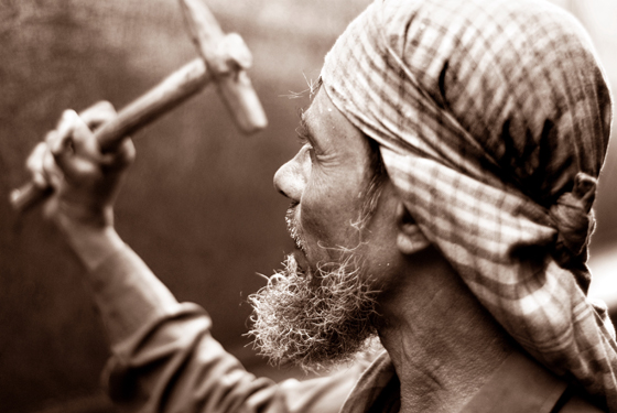 Photo of man with hammer