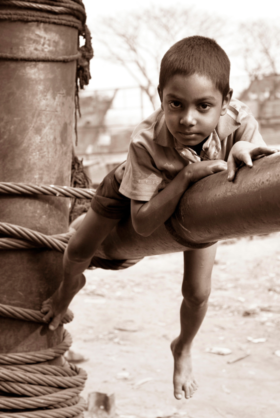 Photo of boy playing on pipe