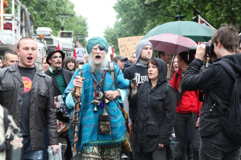 A brightly dressed man joins the Occupy Melbourne protest
