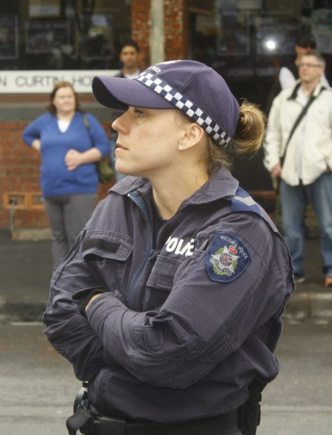 A police officer without her badge