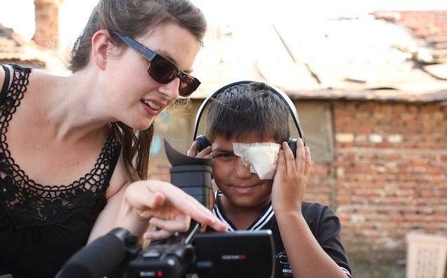 Genevieve Bailey showing Giorgi how to use film camera