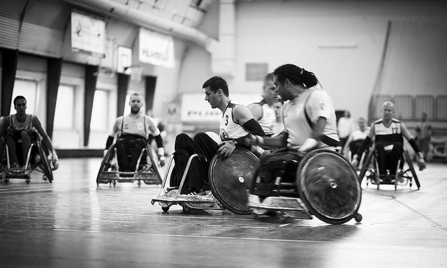 Black and white photo of a men's wheelchair rugby match