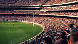 AFL game and crowd