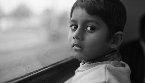 Black and white photo of asylum seekers on Melbourne train