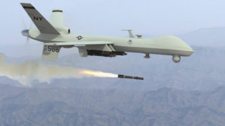 Photo of Predator drone firing missile