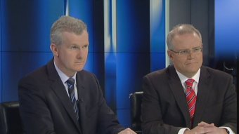 Tony Burke and Scott Morrison on 7.30