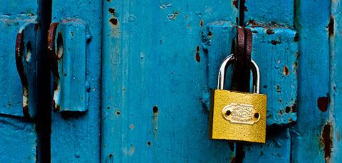 Gold padlock on blue door
