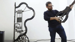 Pedro Reyes playing his instruments, made from gun parts