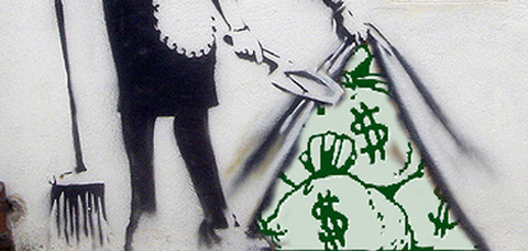 cleaner sweeping moneybags under carpet