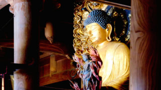 View of a great golden Buddha statue inside the buddhist temple of Shorinin in Ohara, north of Kyoto, Japan