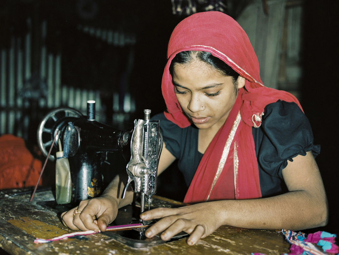 'Rohingya girl in Bangladeshi refugee camp sewing clothes for sale in the market' - The conditions in Myanmar see many Rohingya flee across the Naff River to nearby Bangladesh. However, here the Rohingya are placed in refugee camps, where they are subject to continued abuses by Bangladeshi authorities and locals.