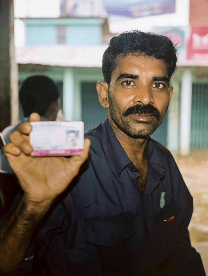 'Rohingya man in Bangladesh holds registered refugee card' - The town of Teknaf, in Bangladesh, has three Rohingya refugee camps: two for registered refugees who arrived in the early 1990's, and one for newly arrived, unregistered refugees. Conditions in the camps are almost indistinguishable from the poverty-stricken Bangladeshi villages that surround them, putting immense pressure on an already over-populated, under-developed country.