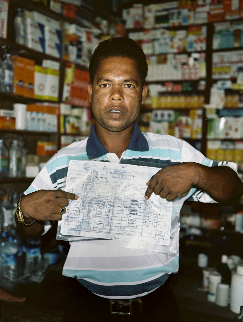 'Rohingya man holding a copy of official documents confirming his family's Rohingya identity.' The Myanmar Government has long denied the existence of the Rohingya ethic group, instead labelling them 'Bengali' due to their Bangladeshi origins. Even under Aung San Suu Kyi, the ban on acknowledging 'Rohingya' continues.
