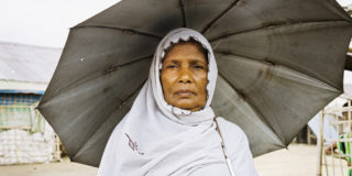 'Rohingya woman in IDP camp outside of Sittwe' - While previously holding the same rights as other Burmese people, Rohingya were excluded from citizenship under a controversial law in 1982. This means that, as non- citizens of Myanmar (or any other country), Rohingya cannot vote or hold office.