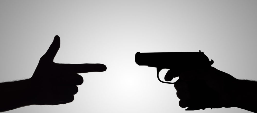 silhouette of the gun in his hand