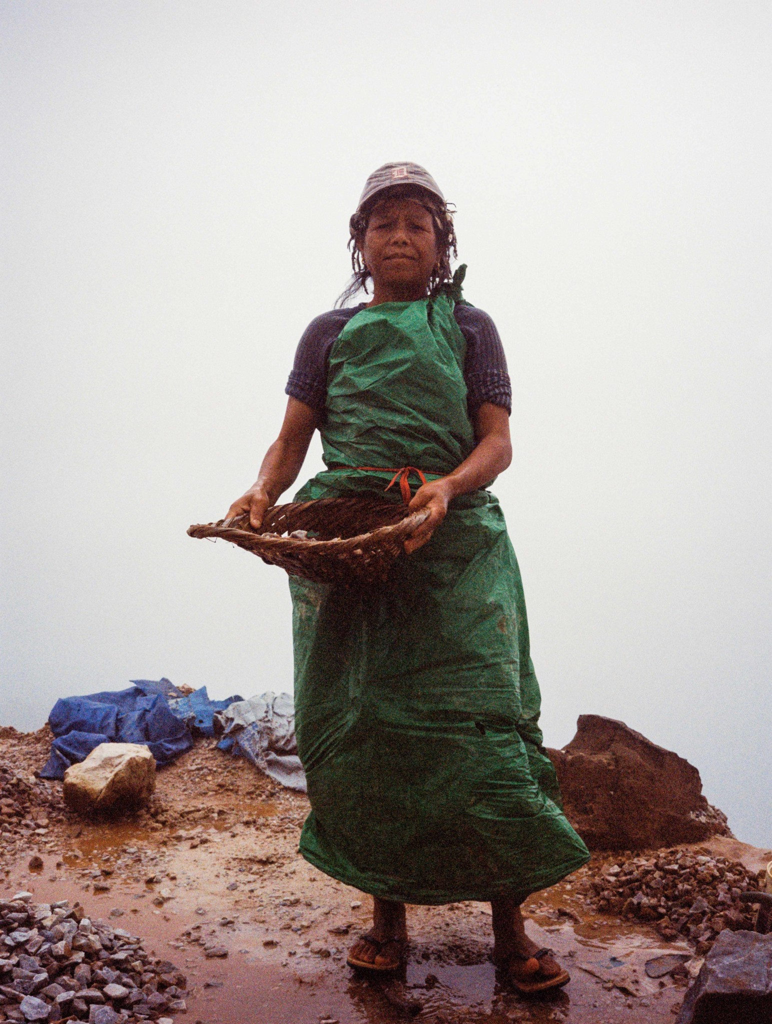 Meghalaya is one of the wettest places on the planet, and the 'nong shain maw' wear brightly coloured tarpaulins to protect themselves from the rain.