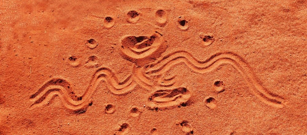 Aboriginal drawing in red sand in central Australia