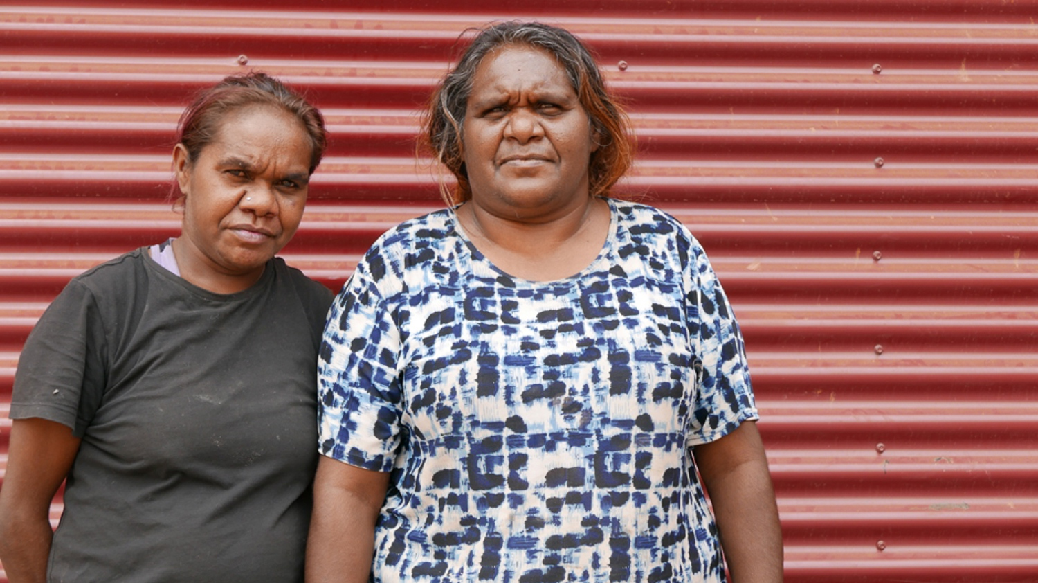 "Donna Sinclair (right), Don Sinclair's daughter, with niece Anika Sinclair. Donna returned to Tjuntjuntjara when she was 18 years old. She says it's important to be back on Spinifex Country. ""This is my tjamu (grandfather's) country. It's important for the next generation to grow up and know where they come from."""