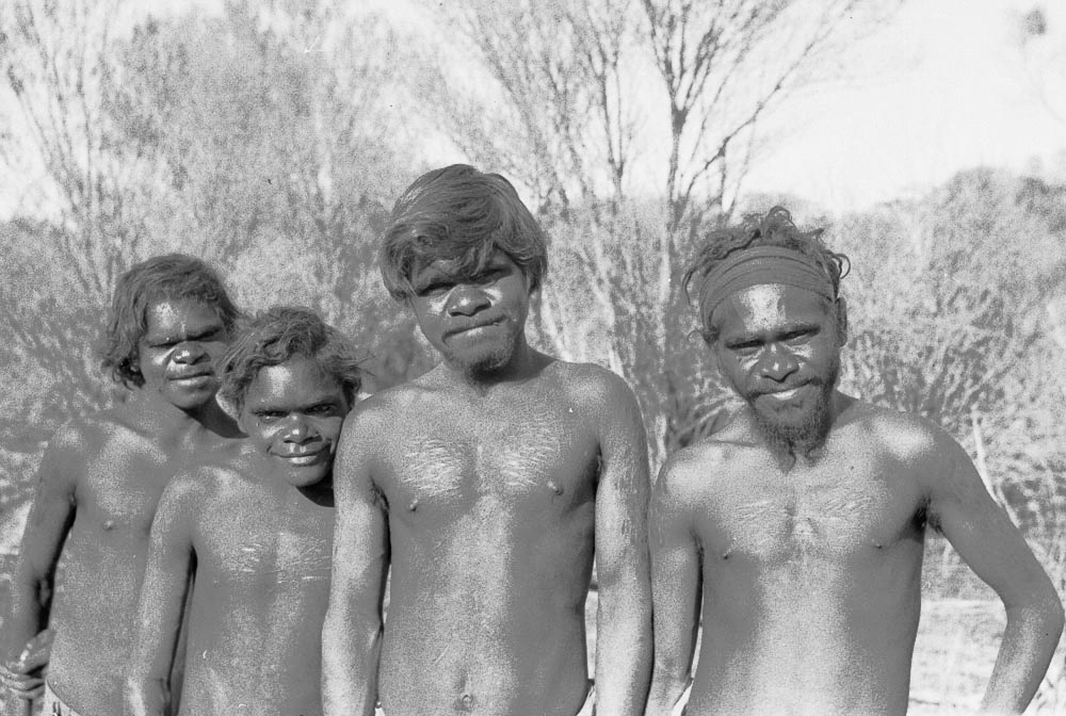 Tom Underwood, Bill Jamieson, Roy Underwood, Roger Jamieson after being 'found' on Spinifex Country, now called the Great Victoria Desert. In the early 1950s, many of the Spinifex People were still living traditional lifestyles deep in the remote desert; this was the first meeting with white people. Roy Underwood would eventually become an internationally recognised artist and would travel the world to tell the story of his people through art.
