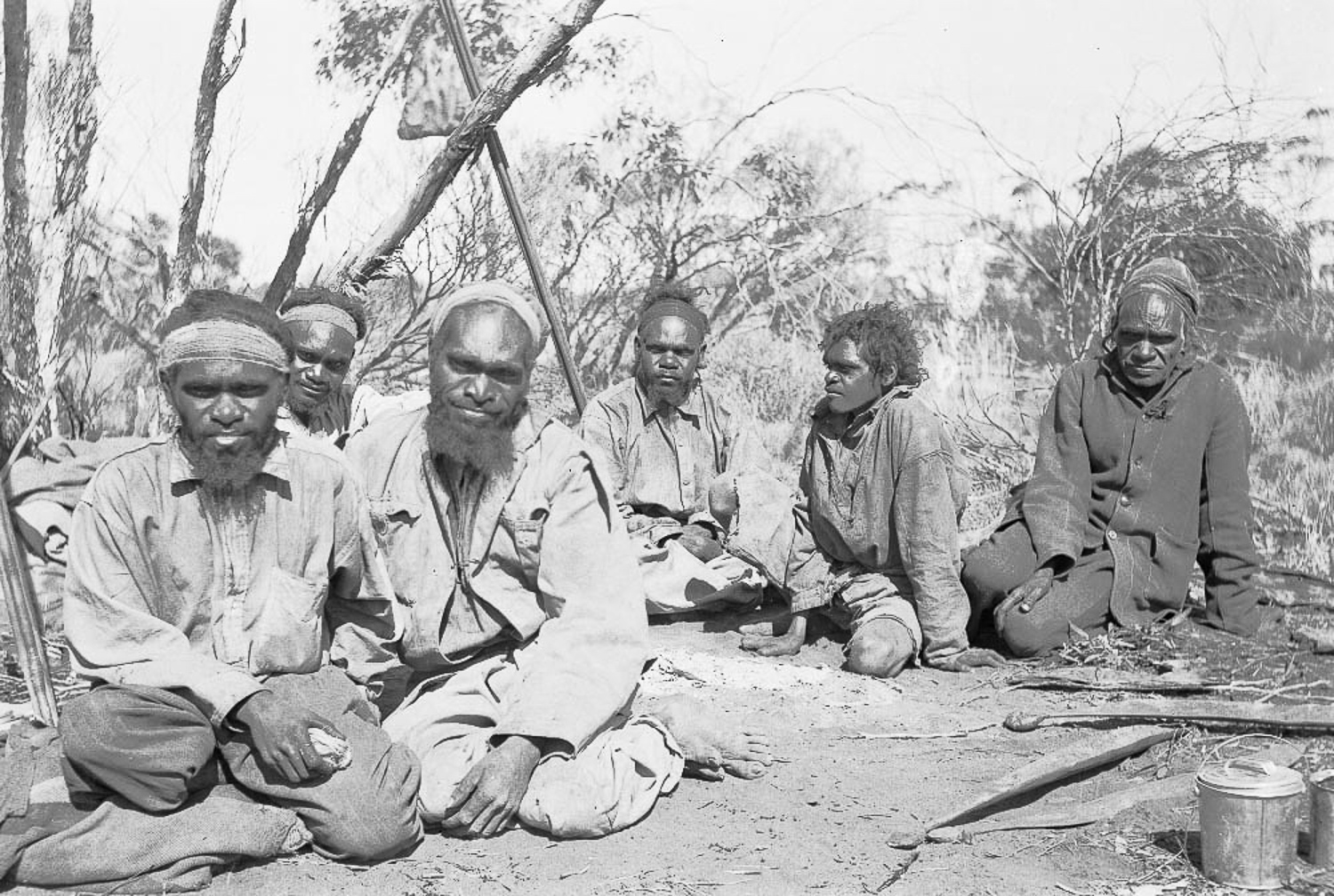 Jack Jamieson, Albert Jamieson, Frank Hogan, Arthur Jamieson and Bill Jamieson with tracker Jimmy Maadi (right) at the ration station, wearing their first set of clothes. Anangu were given western names by the missionaries, as their Indigenous names were deemed too difficult to pronounce. Families were also split up due to a lack of understanding about complex kinship relationships held by Anangu.