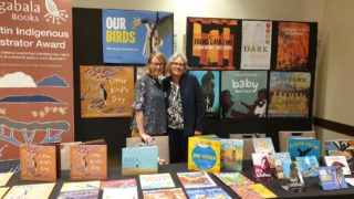 Magabala Books CEO, Anna Moulton, and Chairperson Edie Wright with the Magabala Stall at the NSW Children's Book Council of Australia's professional development conference.