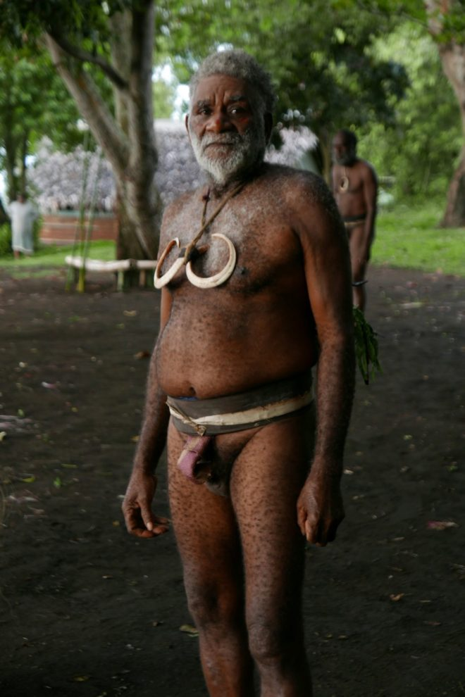 Chief Moltali wearing the traditional namba (penis sheath) and boar tusks signifying his status.