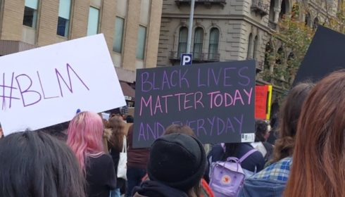 blm signs at melbourne protest june 2020
