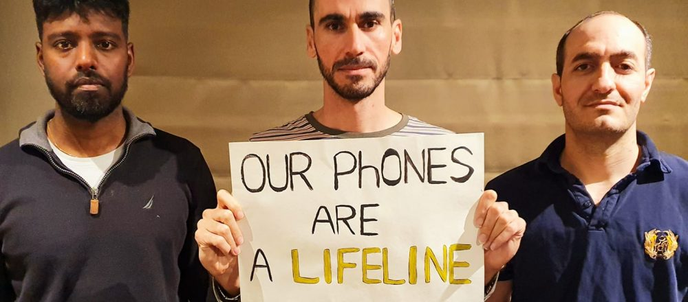 Immigration detainees protesting the mobile phone ban bill