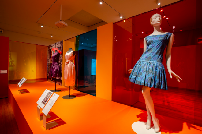 A mannequin in a blue dress in a store  Description automatically generated with low confidence
